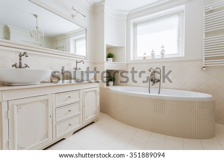 Horizontal picture of luxurious bathroom with window in french style