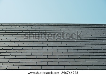 horizontal picture of slates on a roof - stock photo