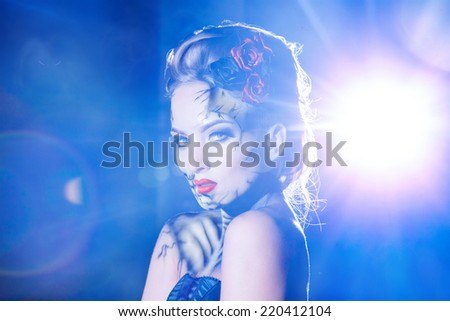 Horizontal portrait for heloween theme of beauty woman with face art outdoors - stock photo