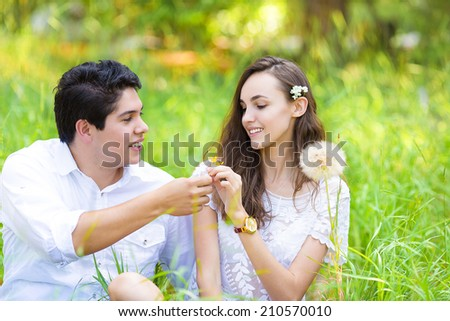 Horizontal Portrait happy, smiling young couple, man and woman, relaxing, enjoying summer sunny day in park. Positive human face expressions, emotions, feelings, life perception. Relationship concept - stock photo