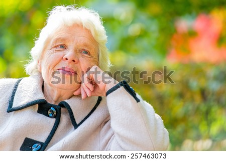 Horizontal portrait of a beautiful pensioner on nature background