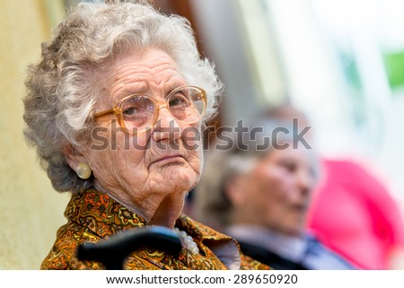 Horizontal portrait of a beautiful pensioner on nature background - stock photo