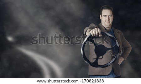 Horizontal portrait of a confident business man behind the wheel when driving car on long stretch of road - stock photo