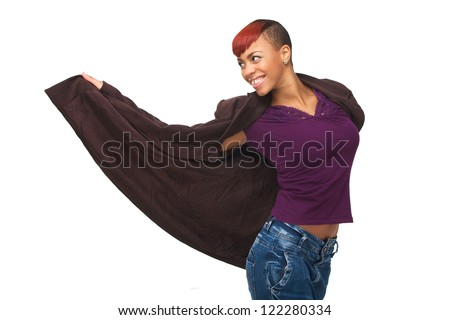 Horizontal portrait of a young African American dancer smiling and holding her jacket open. Isolated on white background - stock photo