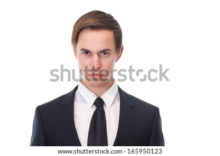 Horizontal portrait of a young business man with serious expression on his face