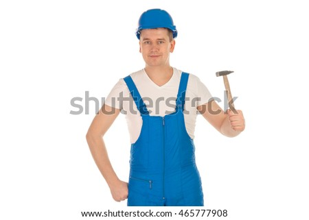 horizontal portrait of man builder in blue uniform with with hammer in hand looking at the camera isolated on white background