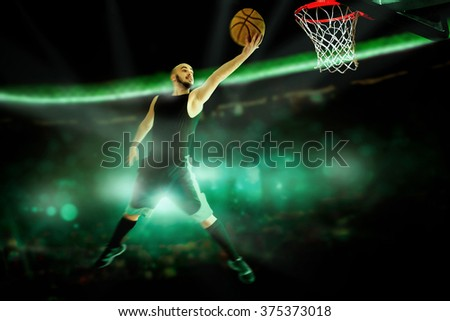 Horizontal portrait of professional basketball player makes slam dunk in the game. Basketball game.  Sportsman plays basketball. - stock photo