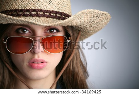 horizontal portrait of the girl in stetson and sunglasses