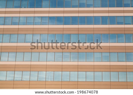 Horizontal row of office building windows in frames - stock photo