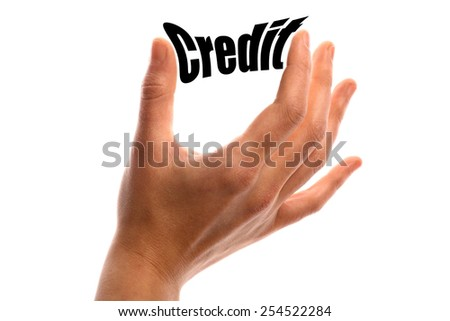 "Horizontal shot of a hand squeezing the word ""Credit"" between two fingers, isolated on white."