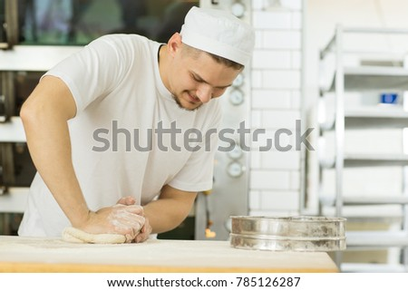 Horizontal shot of a vheerful male professional baker working with dough at th kitchen baking bread and pastry at his bakery copyspace professionalism occupation job people career small business owner