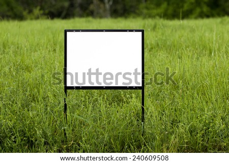 Horizontal Shot Of Blank Sign In Field/ Put Your Copy On This Sign - stock photo