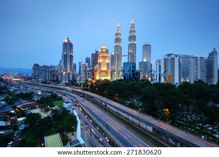 Horizontal shot of Kuala Lumpur night scenery during blue hour. Intentionally added blue tones to make the it look more atmospheric. - stock photo