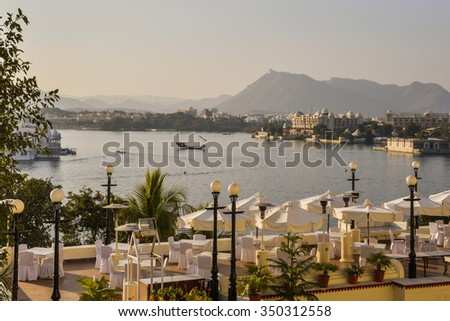 Horizontal shot of Lake Pichola from a restaurant behind the City Palace. This was shot in Udaipur, India. The lake is the focal point of the city and attracts tourists and locals alike. - stock photo