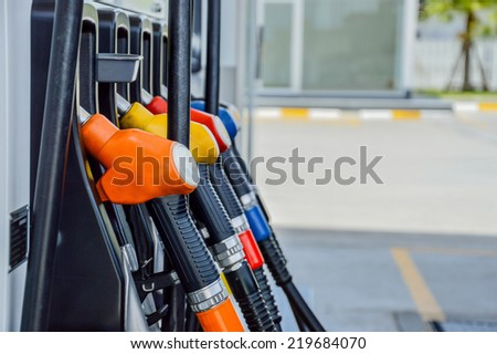 Horizontal shot of some fuel pumps at a gas station. - stock photo
