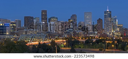 Horizontal shot of the Denver Skyline with beautiful city lights at night. - stock photo