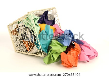 Horizontal shot of wastebasket spilled over with trash/ Wastebasket Full Of Trash Spilling Over - stock photo