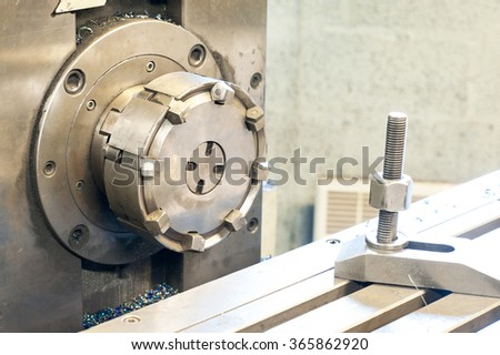 Horizontal side mill machine. Metalworking, mechanical engineering, lathe and milling technology. Indoors horizontal image. - stock photo