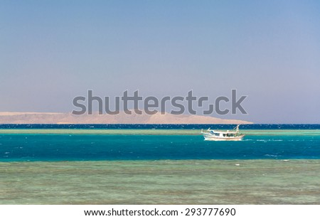 horizontal strip of sand, sea, sky and corals - stock photo