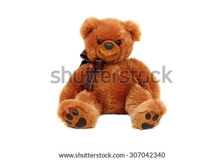 Horizontal studio shot of brown bear toy isolated on white background. - stock photo