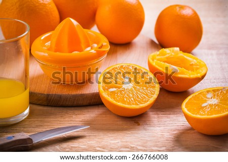 horizontal version juice composition glass knife juicer fruits on wooden table  - stock photo