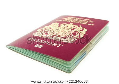 Horizontal view at brand new British passport, narrow focus on word passport - stock photo