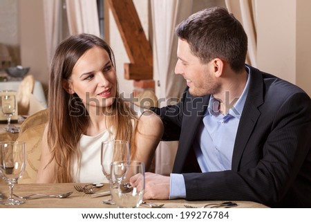 Horizontal view of a couple talking in a restaurant