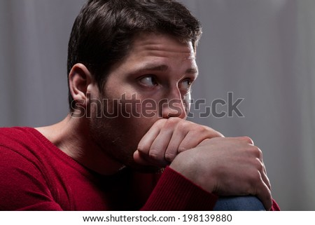 Horizontal view of a depressive young man - stock photo