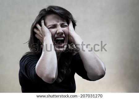 Horizontal view of angry young woman shouting - stock photo