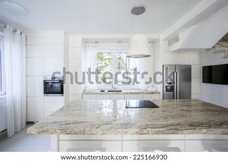 Horizontal view of bright and modern kitchen - stock photo