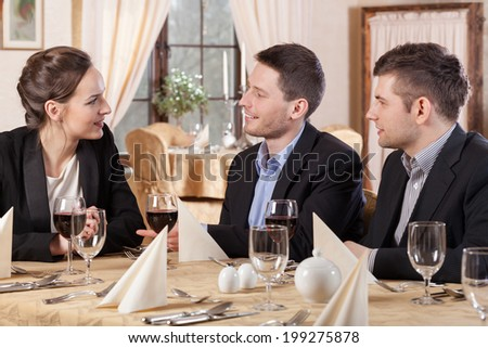 Horizontal view of business meeting in a restaurant - stock photo