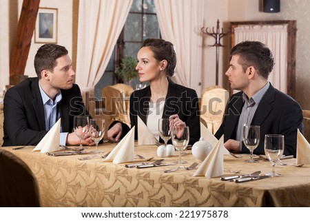 Horizontal view of business meeting in restaurant - stock photo