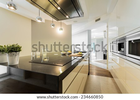 Horizontal view of countertops in designer kitchen - stock photo