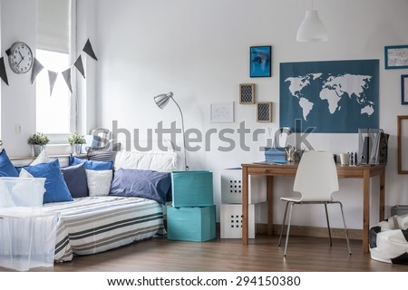 Horizontal view of designed teenage boy room - stock photo