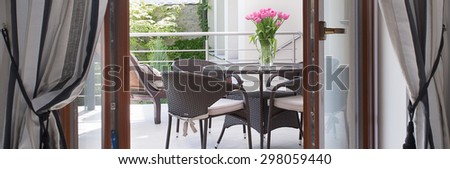 Horizontal view of entrance to cozy terrace - stock photo