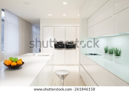 Horizontal view of exclusive white kitchen interior - stock photo
