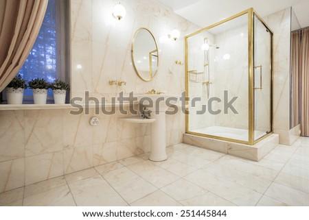 Horizontal view of golden elements inside bathroom - stock photo