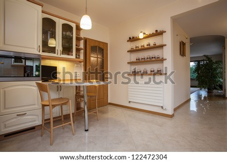 Horizontal view of hall from the kitchen - stock photo