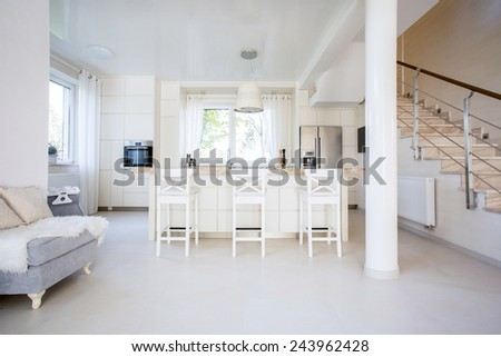 Horizontal view of high chairs in open kitchen