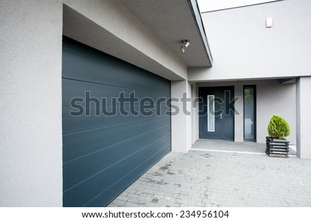 Horizontal view of house with the garage - stock photo