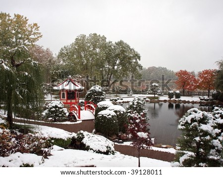 Horizontal view of Japanese garden near Normandale college in Minnesota during snowfall - stock photo