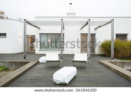Horizontal view of loungers at the patio - stock photo