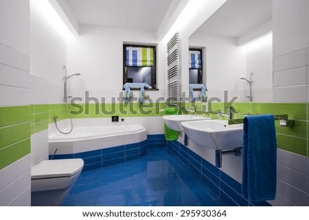 Horizontal view of modern colorful bathroom interior - stock photo