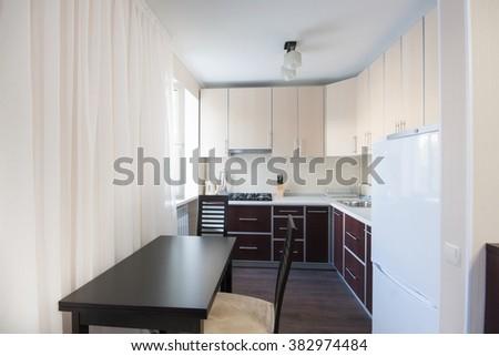 Horizontal view of modern furniture in kitchen - stock photo