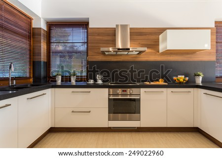 Horizontal view of modern furniture in luxury kitchen - stock photo
