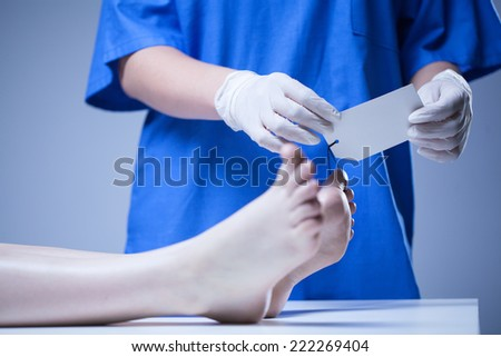 Horizontal view of nurse working in morgue - stock photo