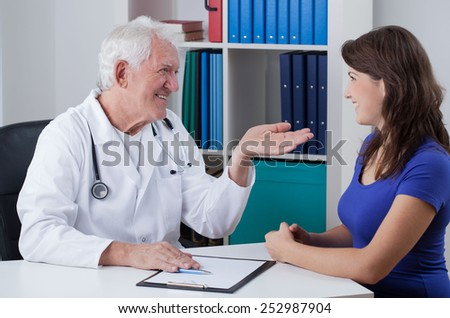 Horizontal view of pleasant visit in doctor's office - stock photo