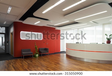 Horizontal view of reception in modern hotel - stock photo