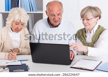 Horizontal view of senior people with laptop