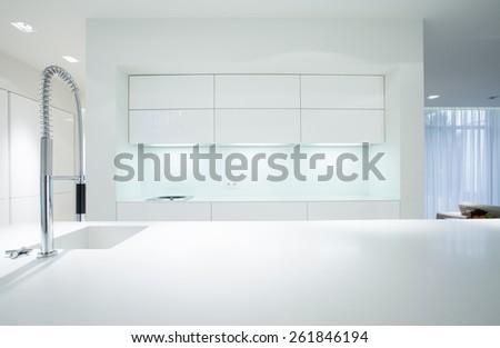 Horizontal view of simple white kitchen interior - stock photo